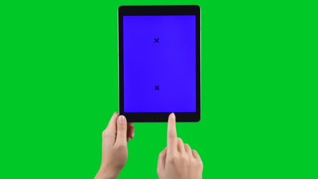 4k using tablet pc displaying chroma key on green screen - vertical stock videos & royalty-free footage