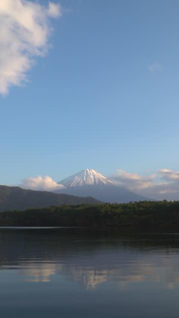 4k vertical: mt fujisan in the sunset time at lake saiko, yamanashi, japan. - vertical stock videos & royalty-free footage