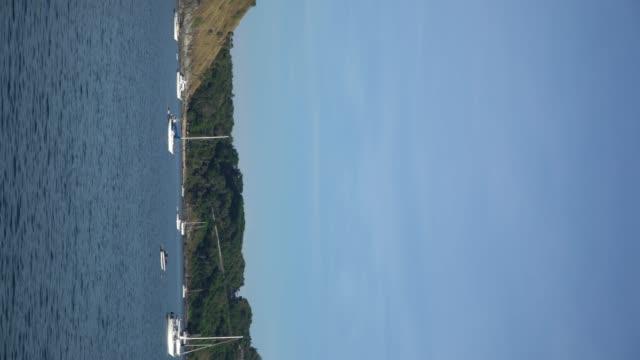 4k vertical shot of yachts on coastline.