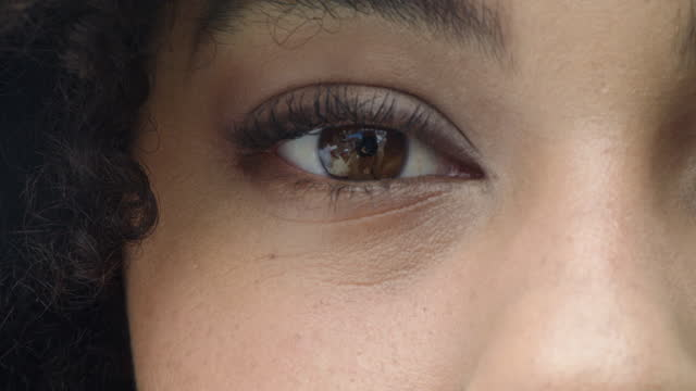 4k video footage of a closeup of a woman's brown eyes - opening stock videos & royalty-free footage