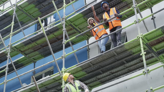 4k video footage of a group of builders working at a construction site - danger stock videos & royalty-free footage