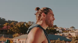 4k video footage of a man drinking water during his workout on a rooftop