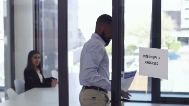 4k video footage of a man entering the boardroom for his interview - chance stock videos & royalty-free footage