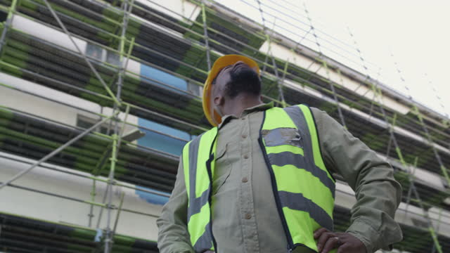 4k video footage of a mature man inspecting a construction site - engineer stock videos & royalty-free footage