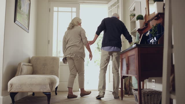 4k video footage of a senior couple leaving their home to go for a walk - husband stock videos & royalty-free footage
