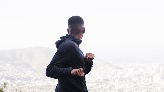 4k video footage of a sporty young man stretching his arms while exercising outdoors - warm up exercise stock videos & royalty-free footage