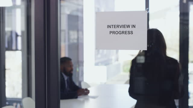 4k video footage of a woman entering the boardroom for her interview - candidate stock videos & royalty-free footage