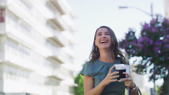 4k video footage of a young businesswoman celebrating while walking through the city - excitement stock videos & royalty-free footage