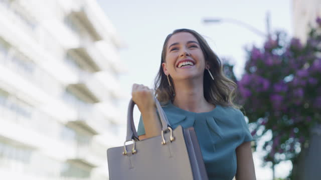 4k video footage of a young businesswoman celebrating while walking through the city - exhilaration stock videos & royalty-free footage