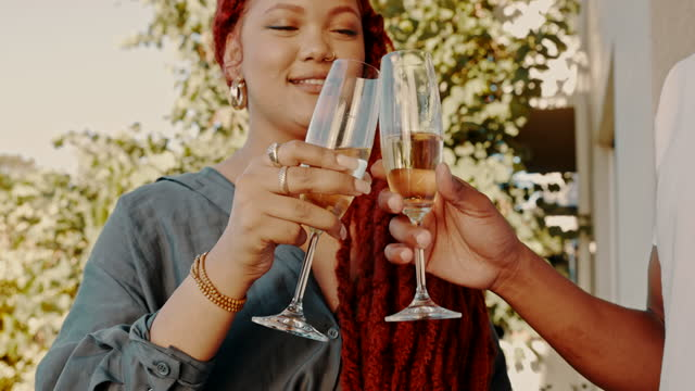 4k video footage of a young couple sharing a toast while standing outside - young couple stock videos & royalty-free footage