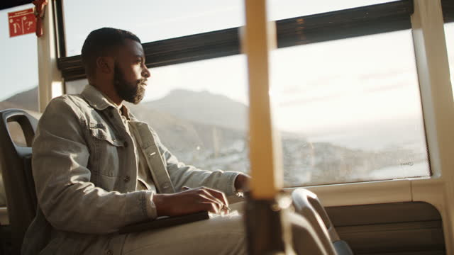 4k video footage of a young man making notes while traveling on a bus - public transport stock videos & royalty-free footage