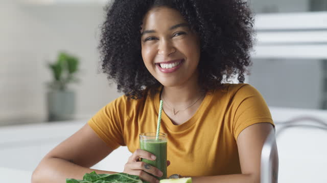 4k video footage of a young woman making a healthy smoothie at home - juice drink stock videos & royalty-free footage