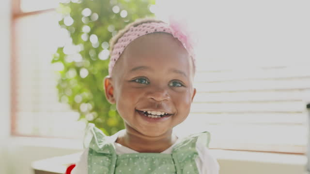 4k video footage of an adorable little girl laughing - cute stock videos & royalty-free footage
