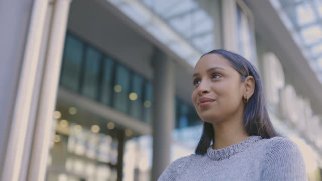 4k video footage of an attractive young businesswoman standing alone in the city - decisions stock videos & royalty-free footage