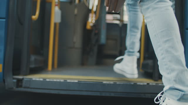 4k video footage of an unrecognisable man getting on a bus - bus stock videos & royalty-free footage