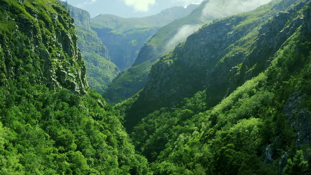 4k video footage of beautiful lush green mountains - valley stock videos & royalty-free footage