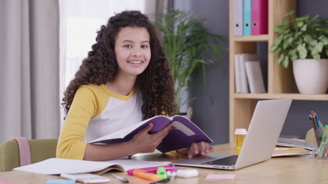 4k video footage of teenage girl using a laptop while doing her school work - junior high stock videos & royalty-free footage