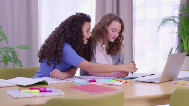 4k video footage of two teenage girls doing their schoolwork together - junior high stock videos & royalty-free footage
