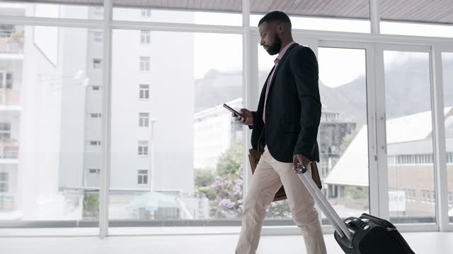 4k video footage of unrecognizable businesspeople walking through the airport with their luggage - business stock videos & royalty-free footage