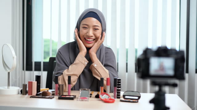 4k video footage of young asian muslim woman influencer talking blogger recording vlog video tutorial and review promoting product with makeup cosmetic on social media live streaming - video stock videos & royalty-free footage