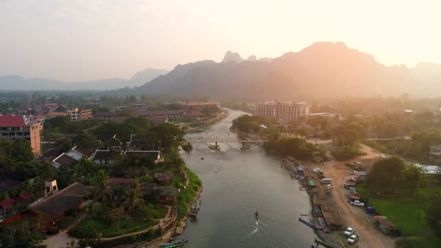 4k video shot aerial view by drone. river at the village of vang vieng on laos. - laos stock videos and b-roll footage