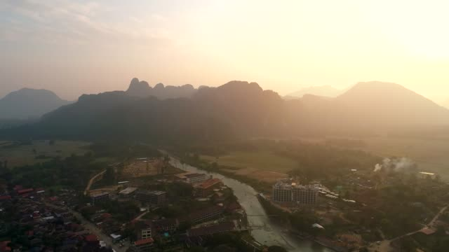 4k video shot aerial view by drone. river at the village of vang vieng on laos. - laos stock videos & royalty-free footage