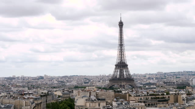 4k view of the paris skyline cityscape include eiffel tower in france. wide panning view of sprawling urban metropolis of the french capital. - avenue des champs elysees stock videos & royalty-free footage