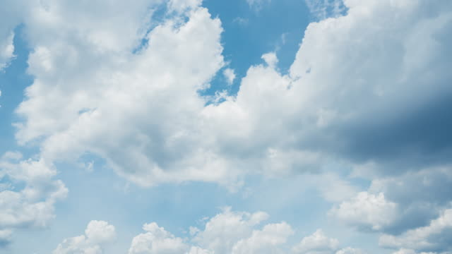 4k t/l white clouds in blue sky - directly below stock videos & royalty-free footage