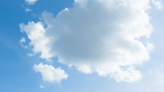 4k T/L white clouds in blue sky