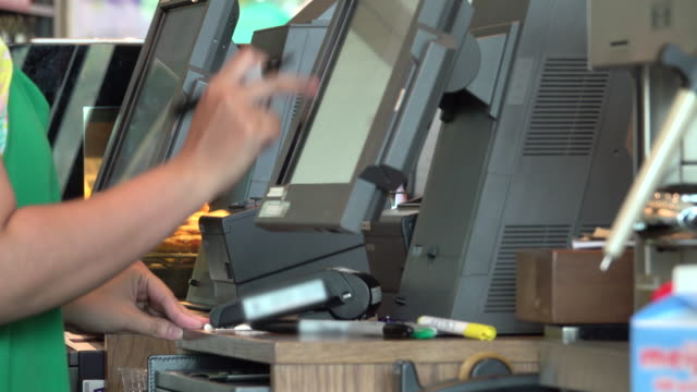 4k: worker using touchscreen cash register at cashier - sales occupation stock videos & royalty-free footage