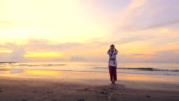 4k: Young women Practising Martial Arts Outdoors On the beach at sunset