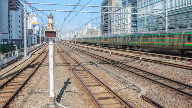 4k zoomout timel apse of tokyo trains and traffic light - apse stock videos & royalty-free footage
