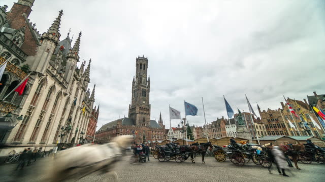 4k_timelapse : grote markt square in bruges, belgium - tower stock videos & royalty-free footage