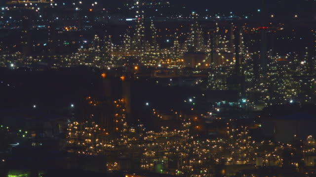 4k:aerial view of land scape of oil refinery plant at night - tank stock videos & royalty-free footage