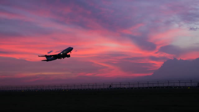 4K:Airplane take off in evening and twilight sunset sky