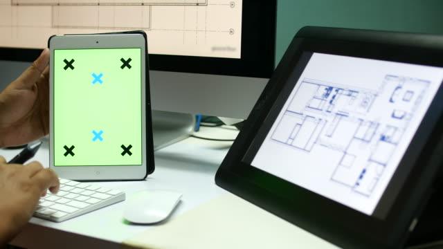 4K:Architect working on Digital tablet,Green screen