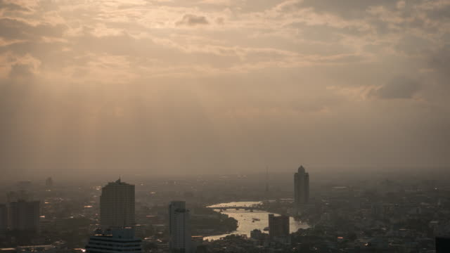 4k:bangkok city during sunset : day to dusk time-lapse - day to dusk stock videos & royalty-free footage