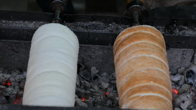 4K:Bread roll grill in christmas market
