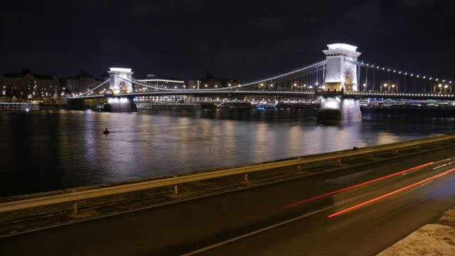 4k:budapest hungary chain bridge at night time-lapse movement - széchenyi chain bridge stock videos and b-roll footage