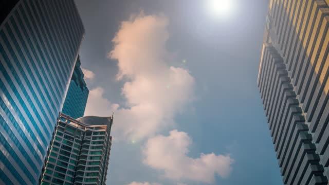 4 k: gebäude zeitraffer-business center - office block exterior stock-videos und b-roll-filmmaterial