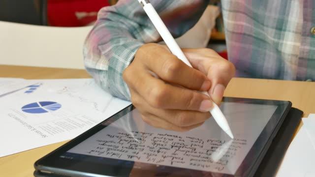 4K:Businessman using Digital pen writing note on Digital Tablet display screen