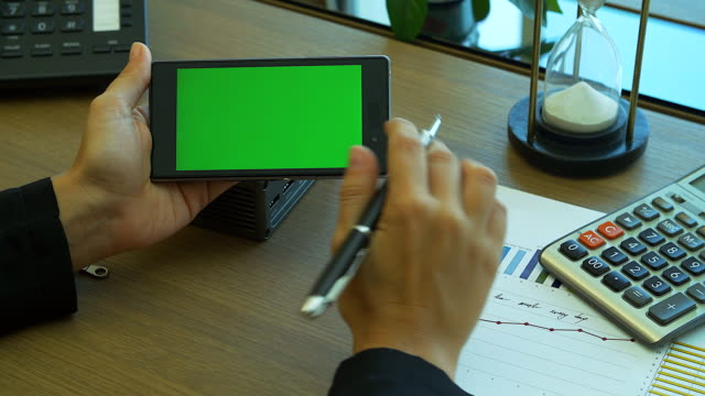 4K:Businesswoman touch blank green screen mobile display for your own presentation or business concept.