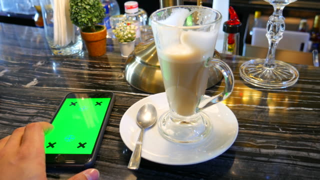 4k:chroma key:play mobile phone with coffee - coffee drink stock videos & royalty-free footage