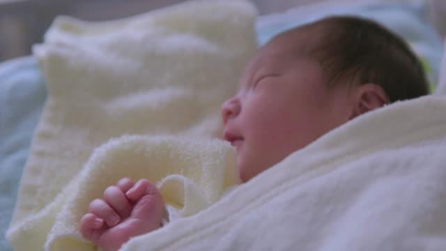 4K,Close up shot of Japanese newborn baby sleeping.