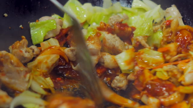 4K:Close-up:Professional Chef cooking famous Korean dish