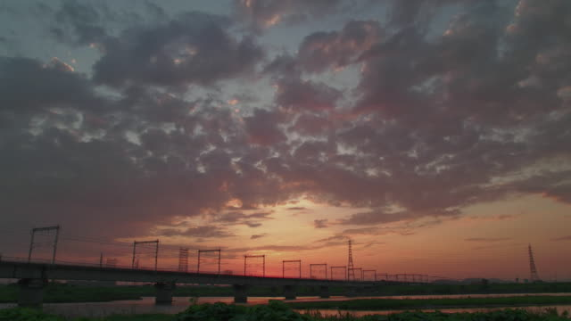4k,cloudscape at kakogawa river.kakogawa,hyogo,japan - electricity pylon stock videos & royalty-free footage