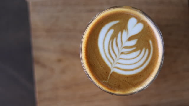 4k:coffee with art latte on the table of coffee shop - latte stock videos and b-roll footage