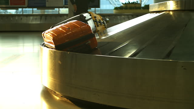 4K:Conveyor belt in arrivals lounge at the airport.