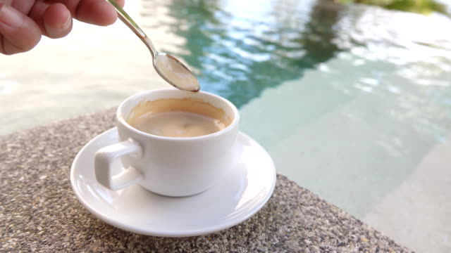 4k:cup of coffee - teaspoon stock videos and b-roll footage
