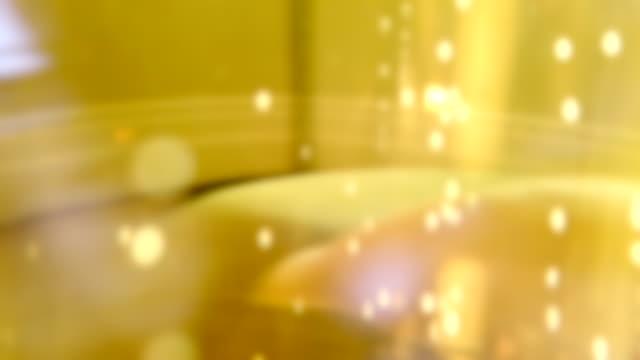 4k:defocused beer bubbles - pilsner stock videos & royalty-free footage
